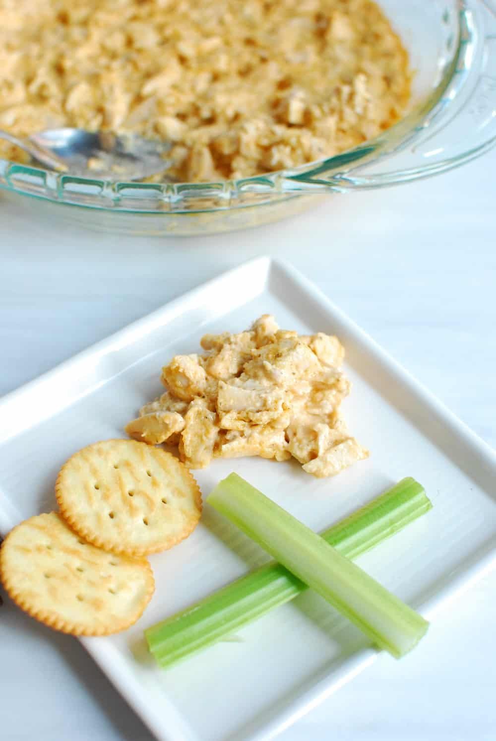 Celery, crackers, and dairy free buffalo dip