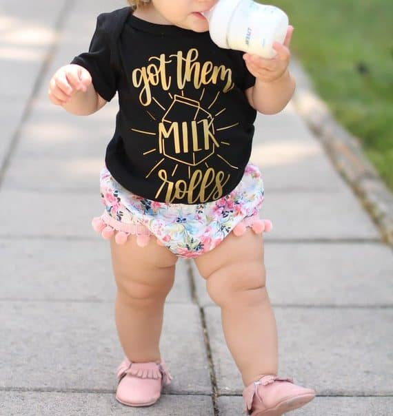 Cute breastfeeding onesie on a baby