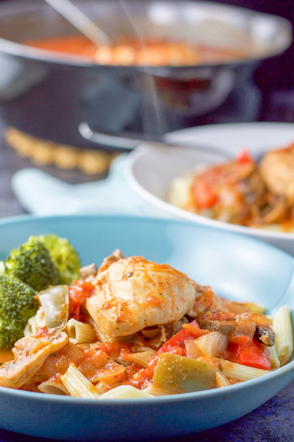 Instant pot chicken cacciatore in a bowl over gluten free pasta