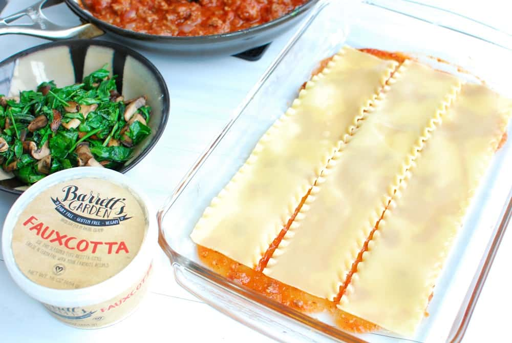 Layering lasagna noodles in a baking dish