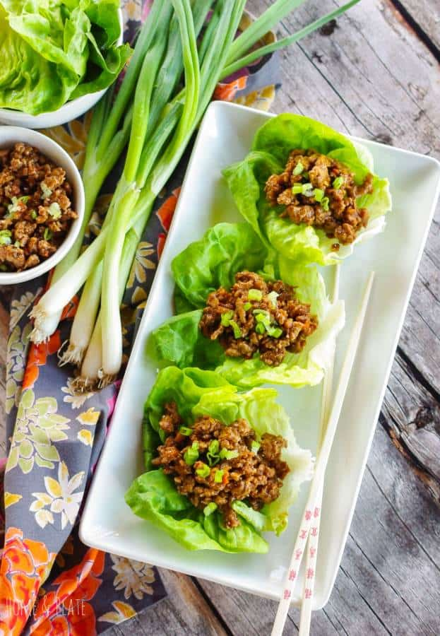 Dairy Free lettuce wrap appetizer on white tray next to green onions