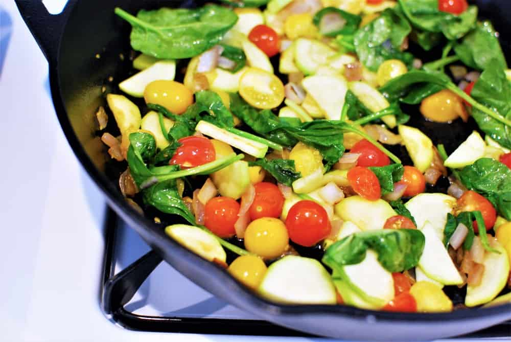 Sauteing vegetables in a cast iron skillet