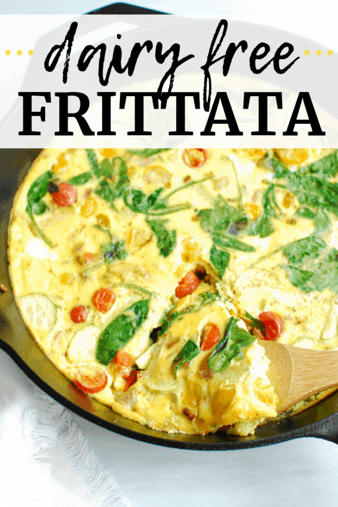 A cast iron skillet with dairy free frittata, and a wooden utensil