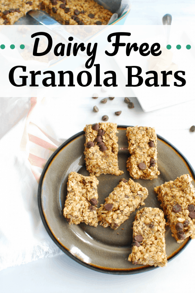 Dairy free granola bars on a black plate next to a napkin and chocolate chips