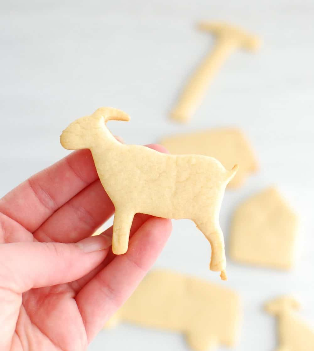 Close up of a goat-shaped dairy free sugar cookie