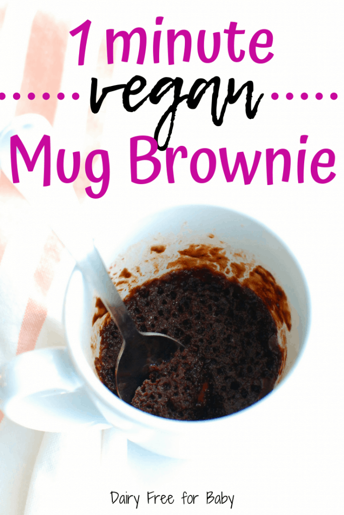 Vegan mug brownie after being cooked with a spoon in the mug