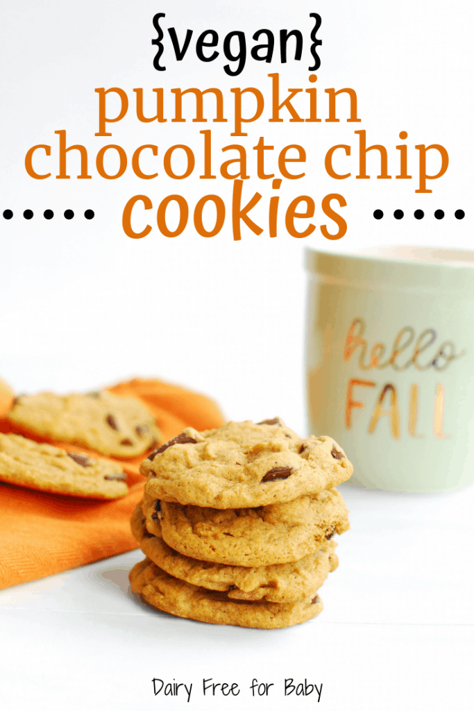 A stack of vegan pumpkin chocolate chip cookies next to a fall mug and an orange napkin