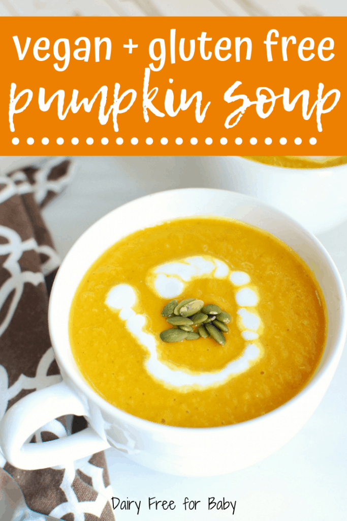 A bowl of vegan pumpkin soup garnished with pumpkin seeds