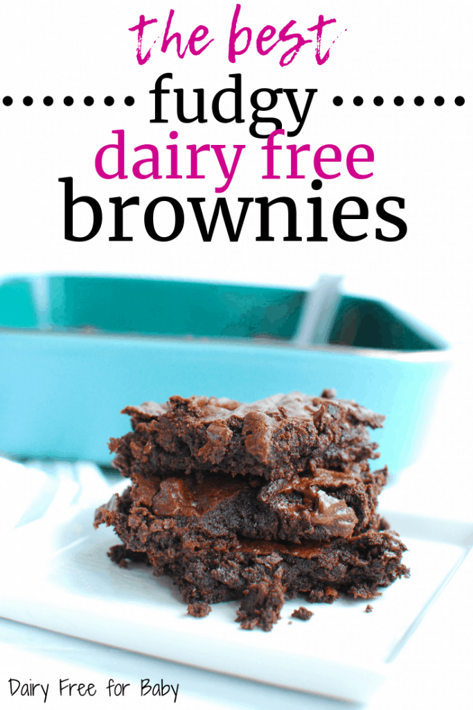 Several dairy free brownies stacked on a white plate