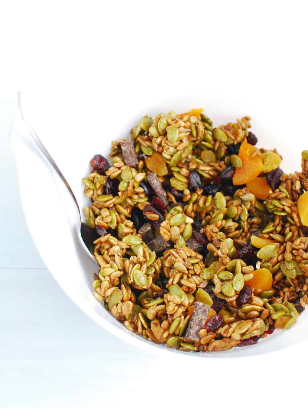 A white bowl full of nut free trail mix