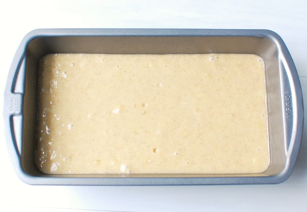Unbaked banana bread batter in a loaf pan