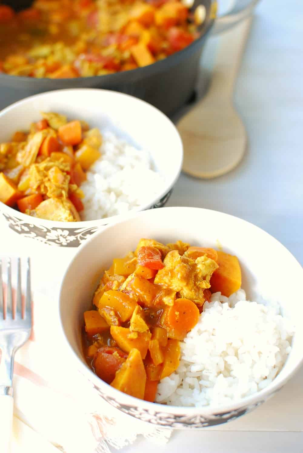 leftover turkey yellow curry in a white bowl