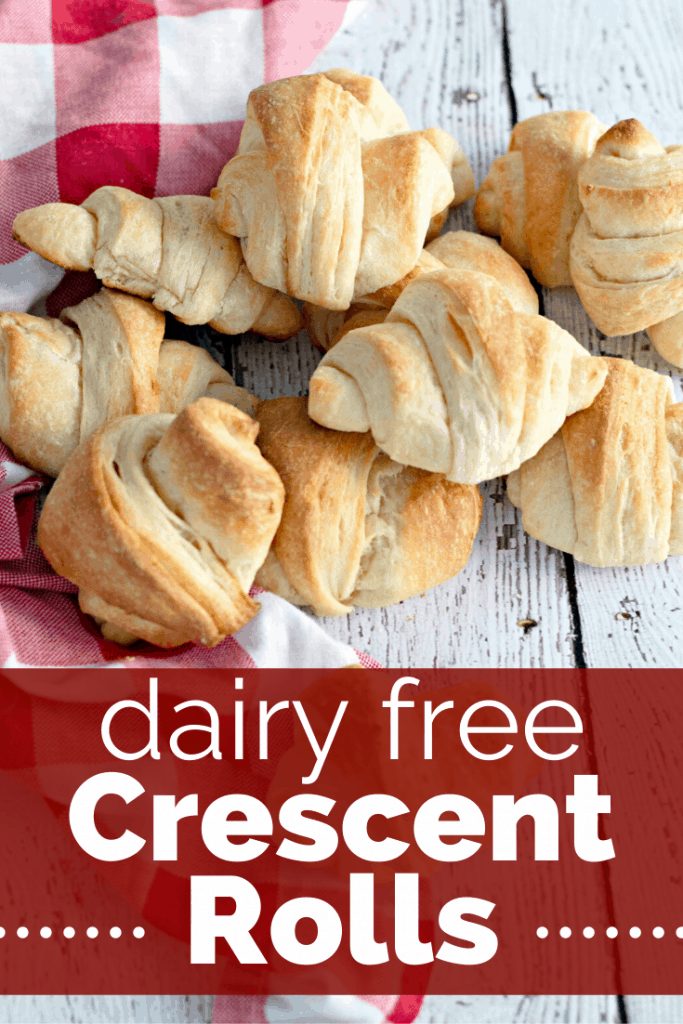 dairy free crescent rolls in a pile next to a checkered napkin