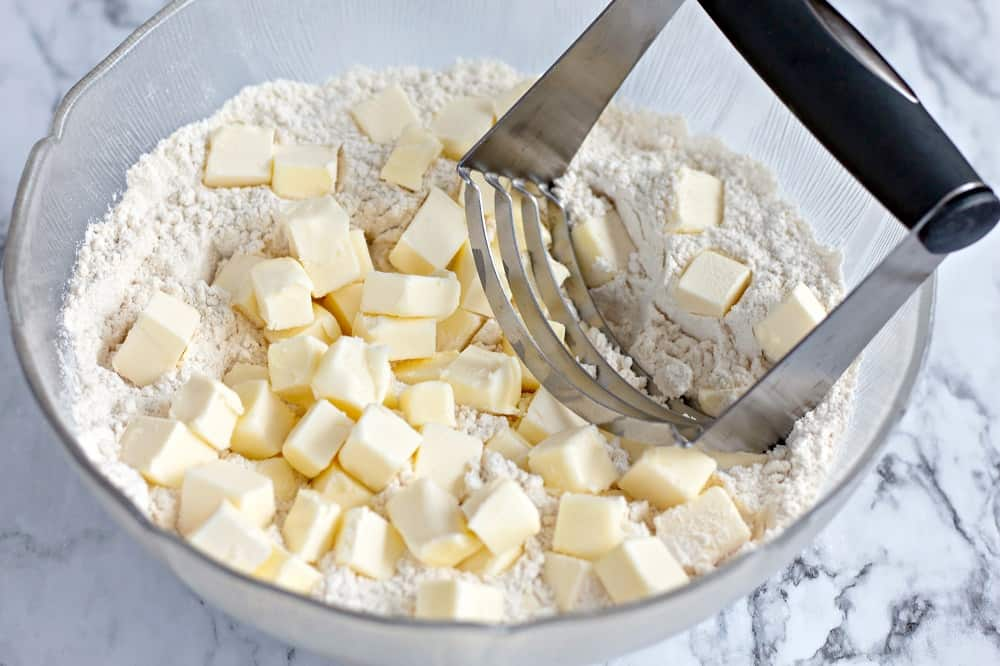 dairy free butter being mixed into flour