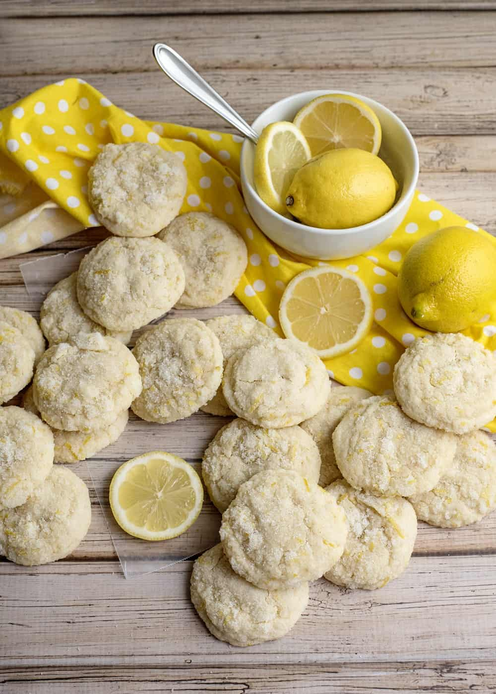 a lot of vegan lemon cookies on a wooden table