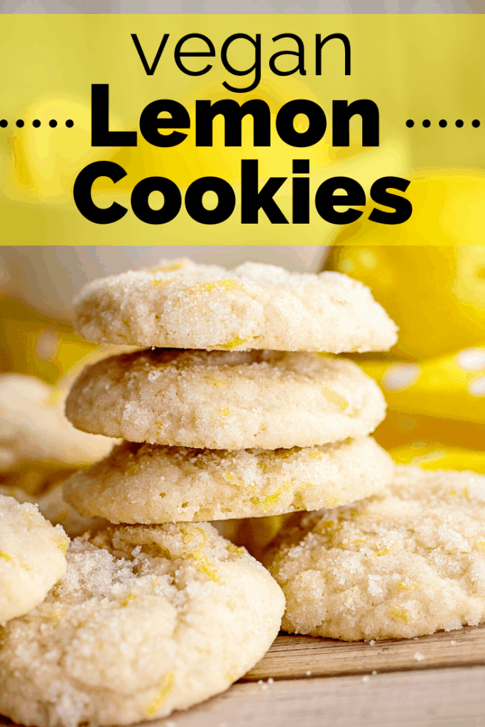 A stack of vegan lemon cookies on a wooden table