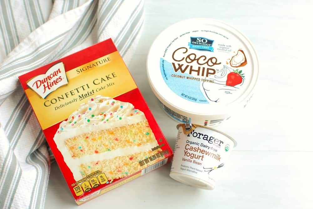 a box of confetti cake mix, a container of cocowhip, and a dairy free yogurt