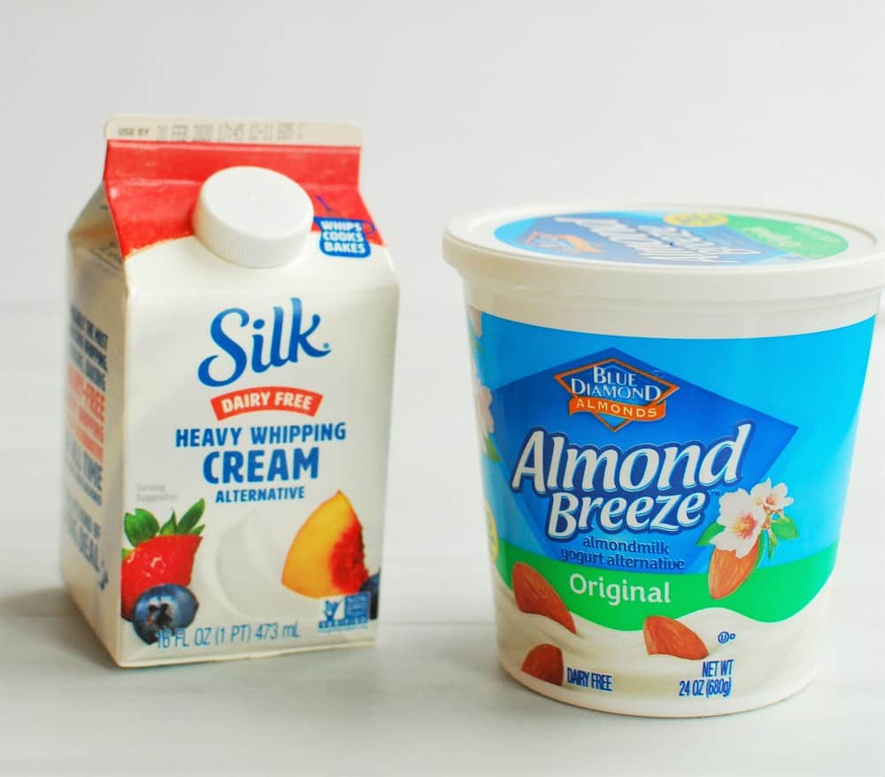 A container of Silk heavy whipping cream and almond breeze yogurt