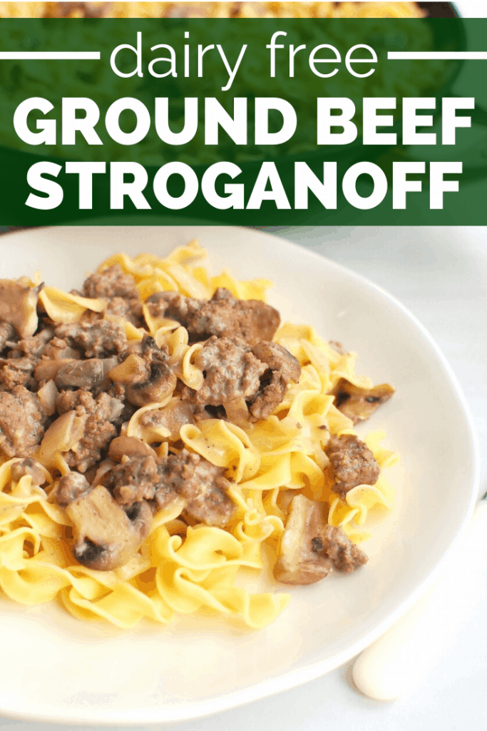 Dairy free beef stroganoff over egg noodles on a white plate