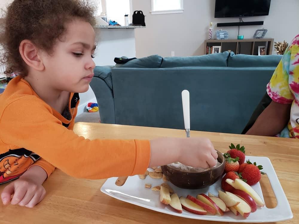 a child eating dairy free cake batter dip