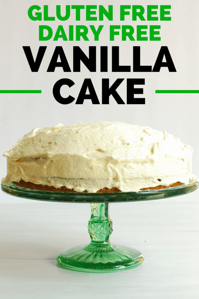 A frosted vanilla gluten free dairy free cake on a cake stand