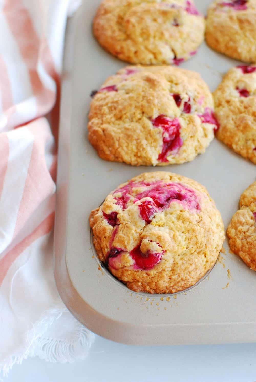a muffin tin full of cranberry orange muffins