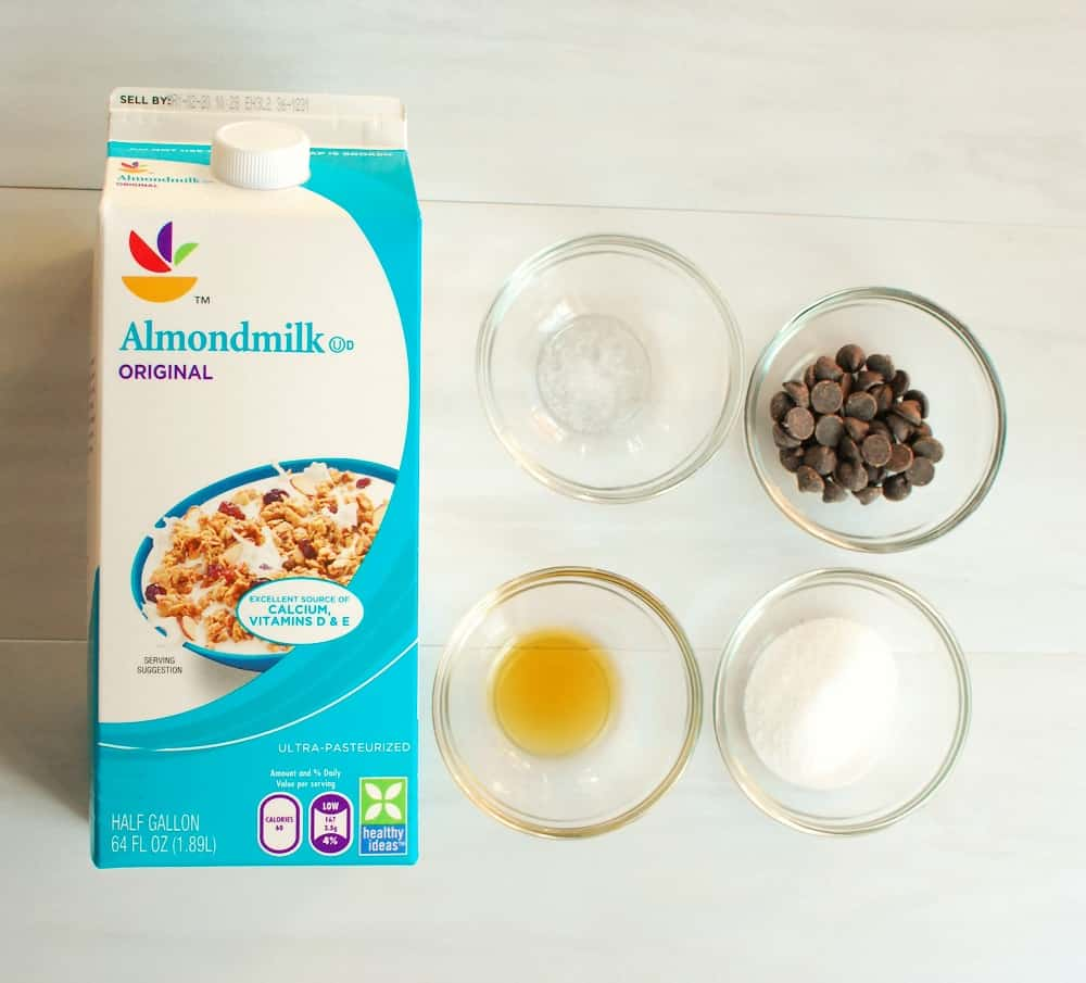 a container of almond milk, vanilla, salt, chocolate chips, and sugar