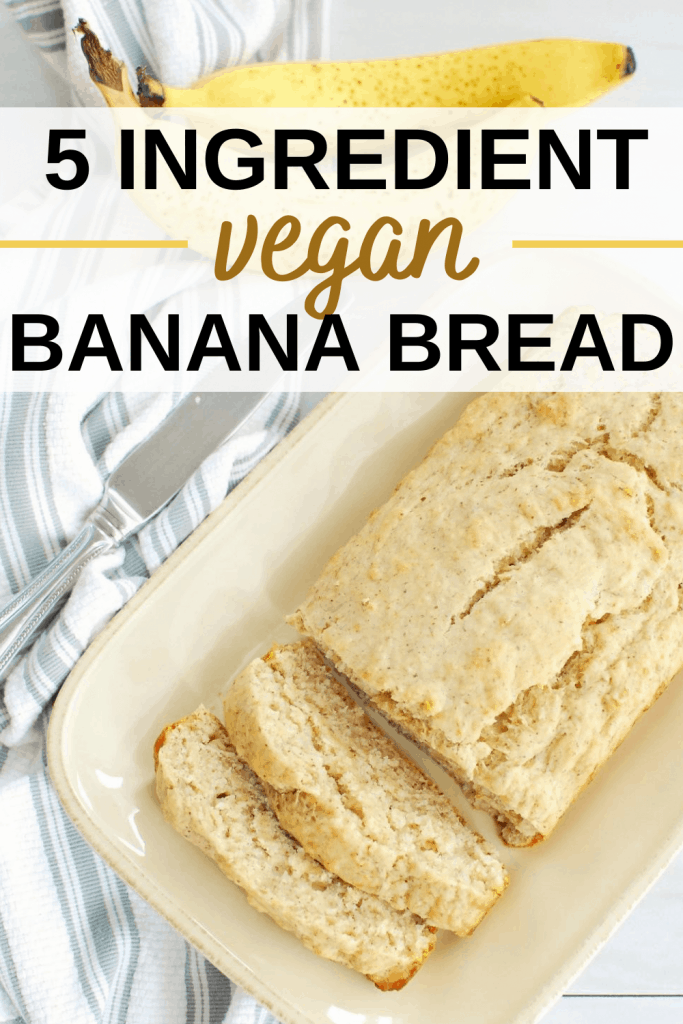 a cream-colored plate with a loaf of vegan banana bread that's been sliced twice