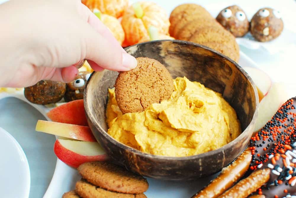 Pumpkin dip on a Halloween charcuterie board with gingersnaps