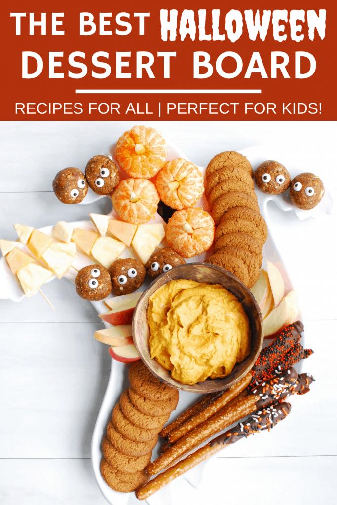 a Halloween charcuterie board filled with five different festive dessert treats