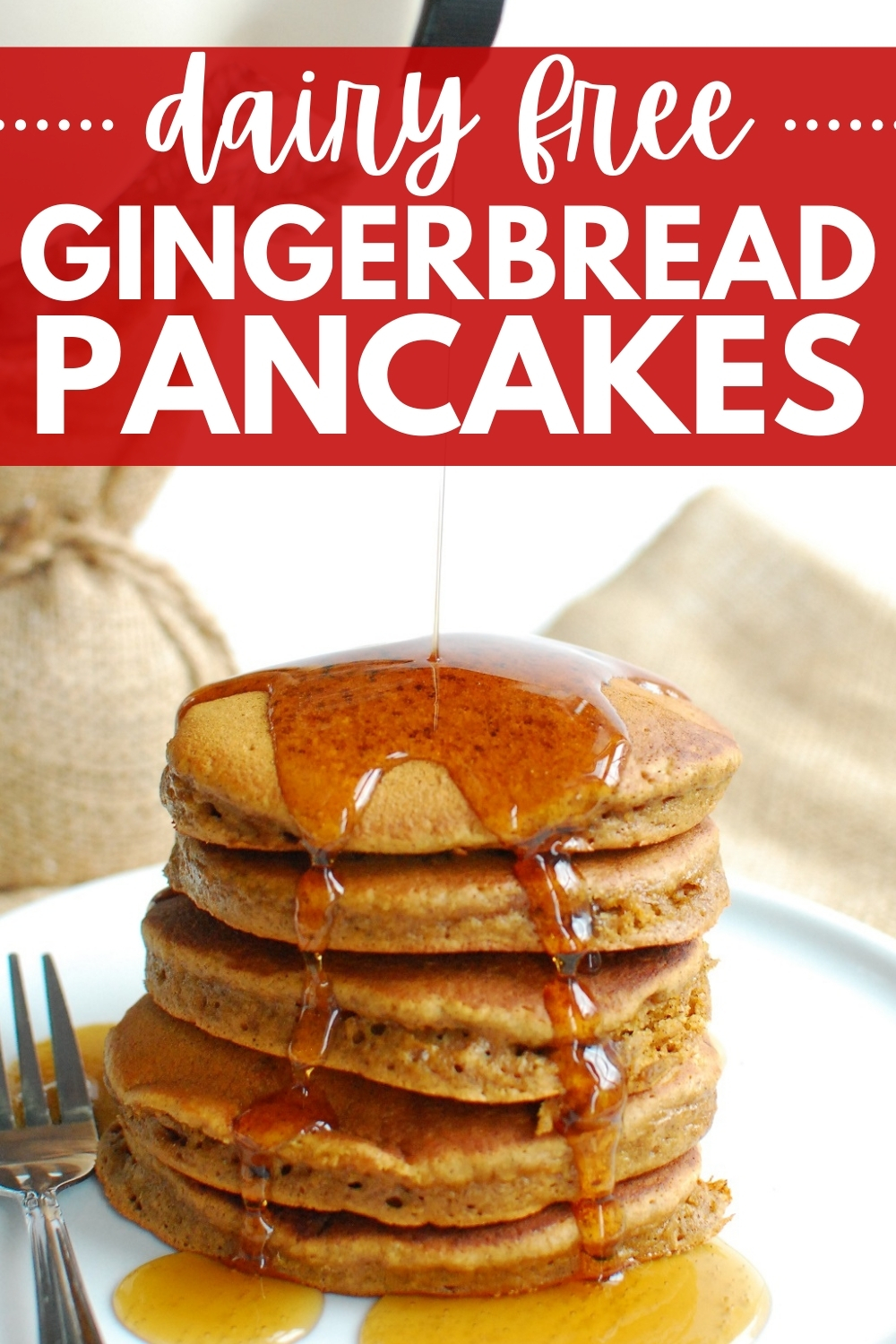 a stack of gingerbread pancakes with syrup being poured over the top