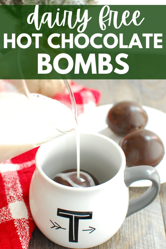 milk being poured into a mug with a dairy free hot chocolate bomb