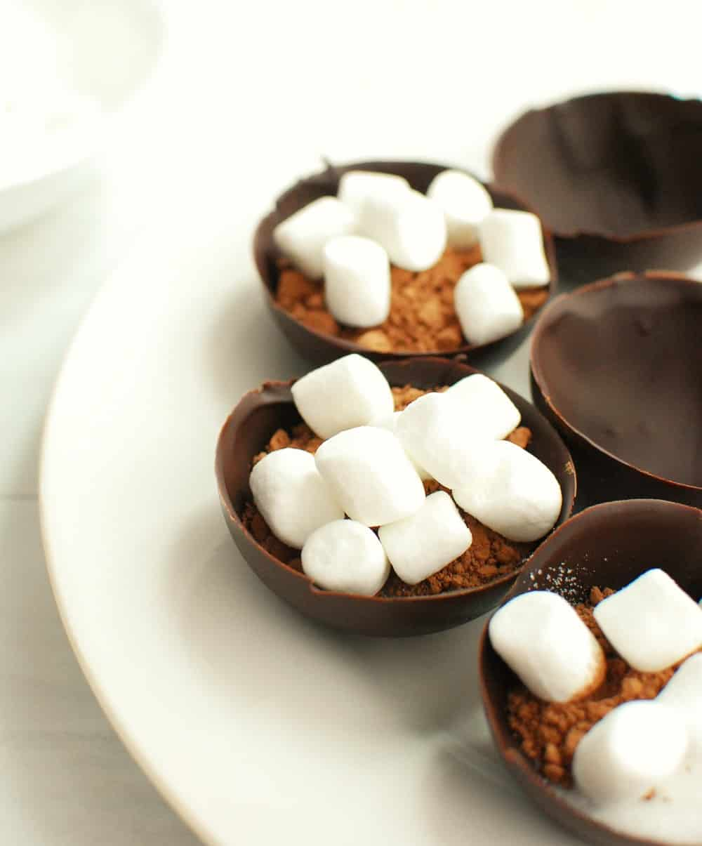 chocolate half circles filled with cocoa, sugar, and mini marshmallows