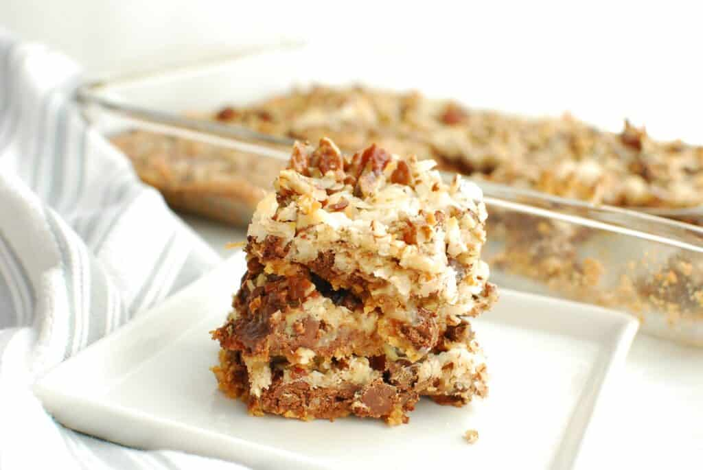several dairy free magic bars on a white plate