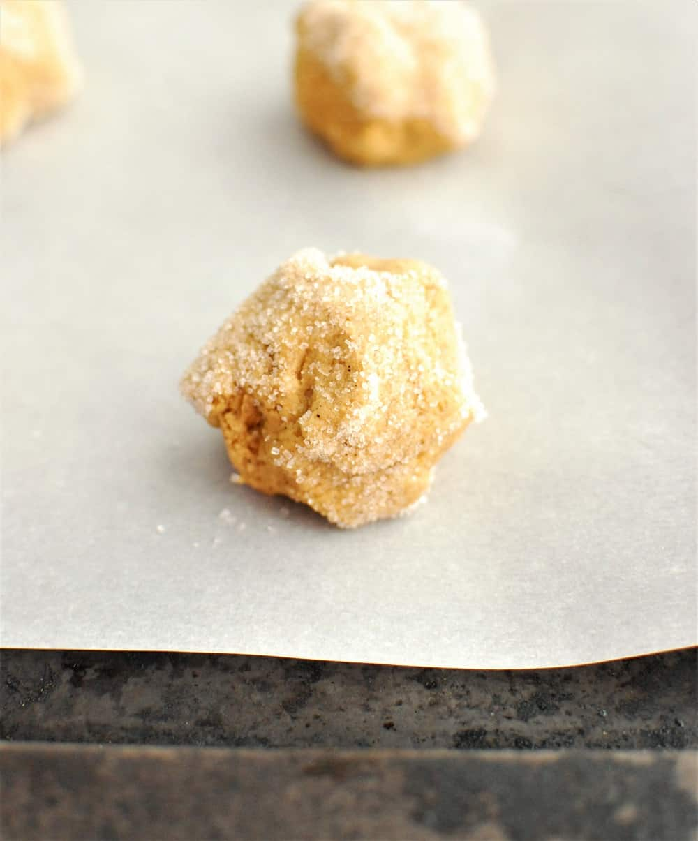 cookie dough balls rolled in granulated sugar
