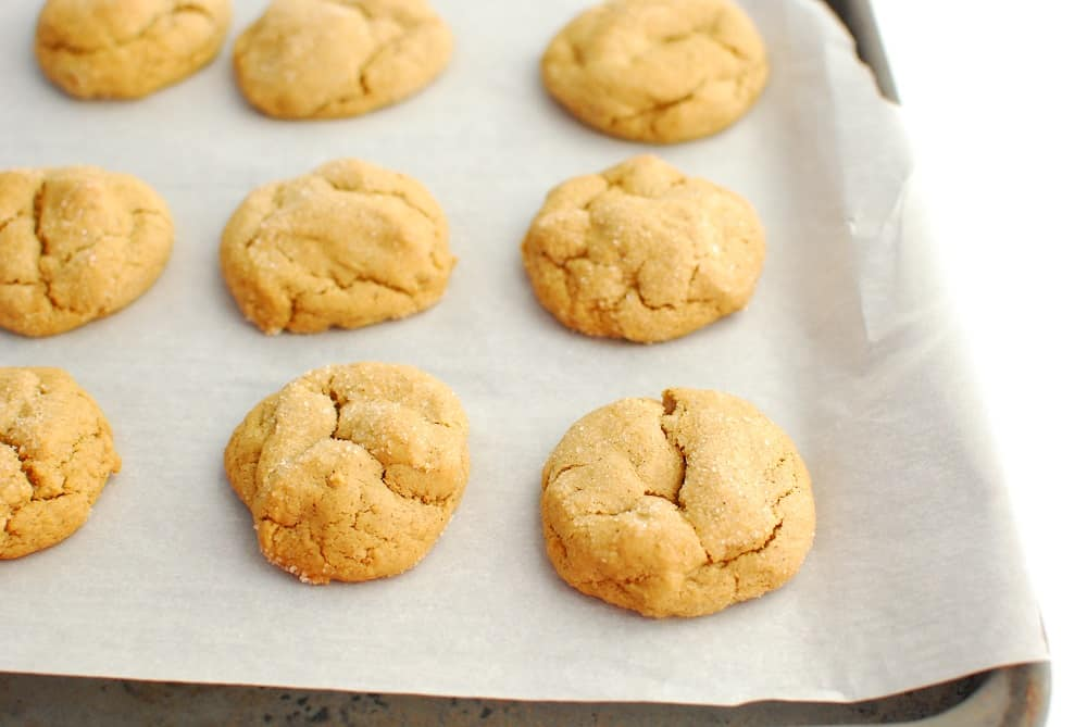 a pan with freshly baked molasses cookies