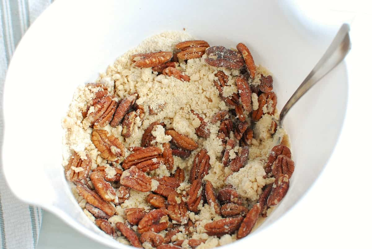the topping in a bowl made with flour, brown sugar, dairy free butter, salt and pecans