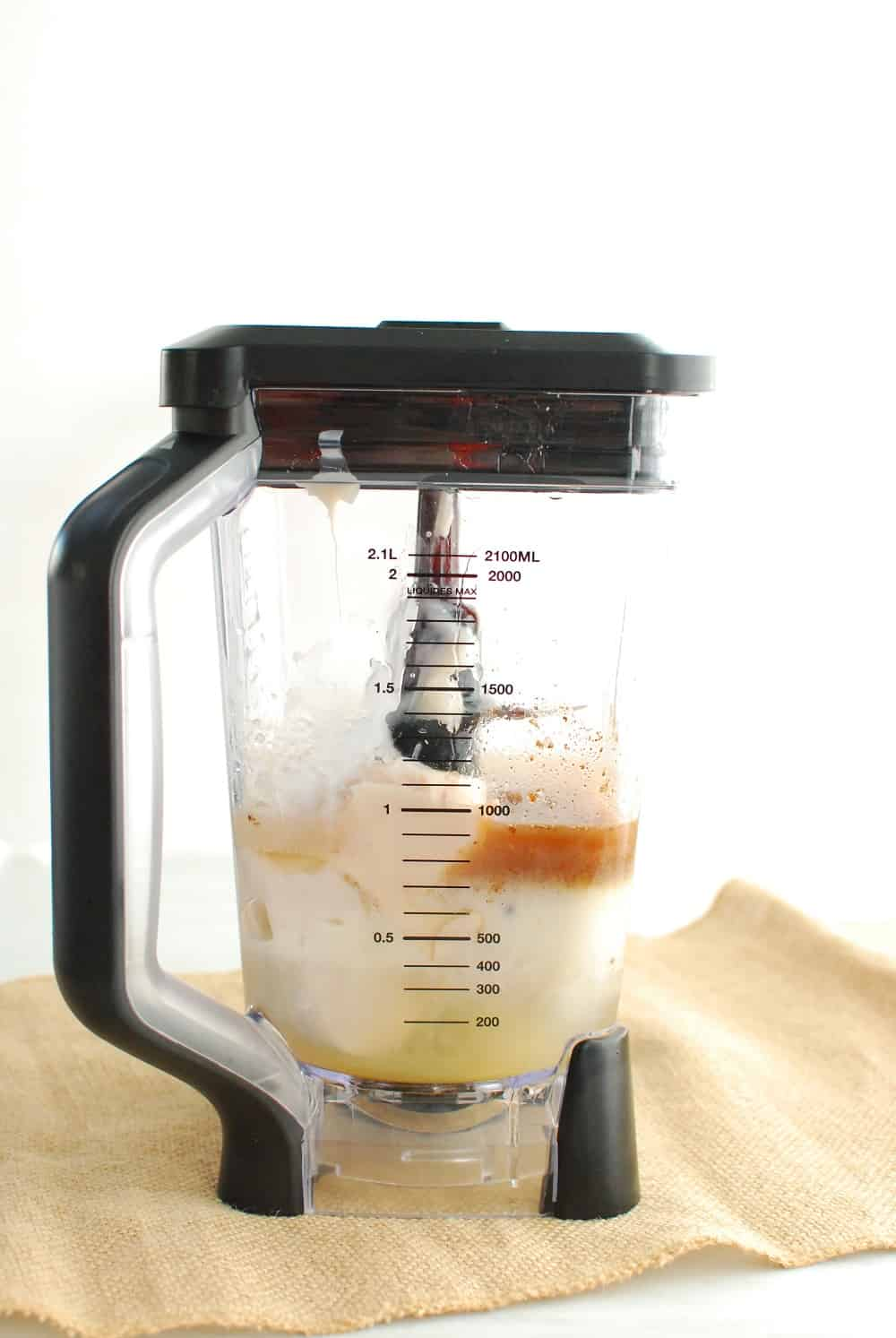 a blender filled with ingredients to make dairy free coquito