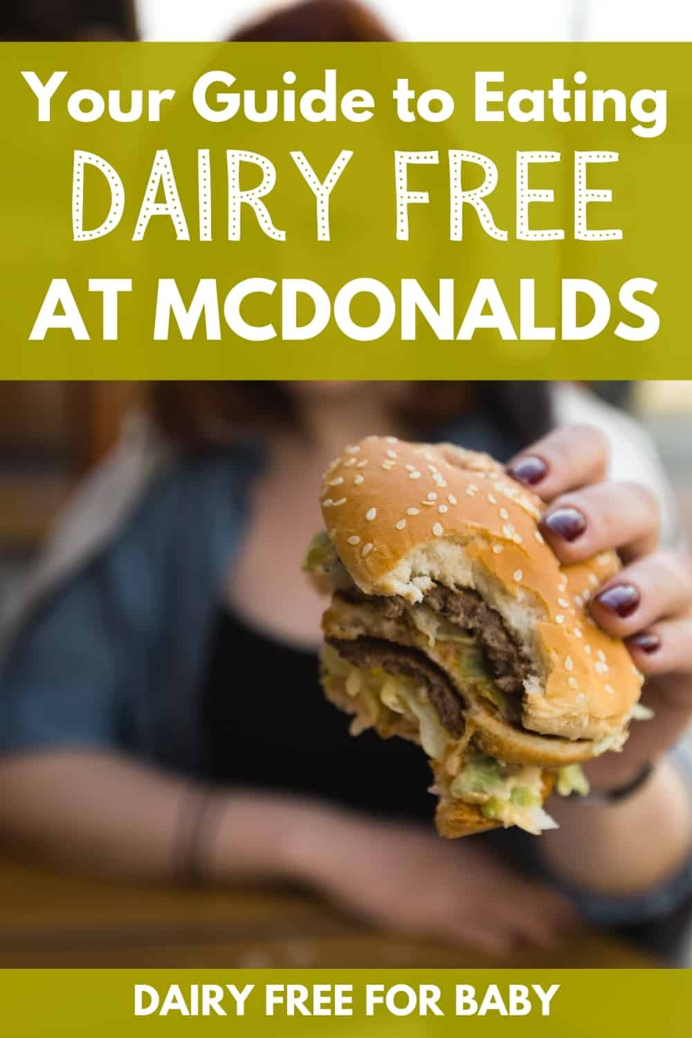 a woman holding a double hamburger with a text overlay that says your guide to eating dairy free at mcdonalds