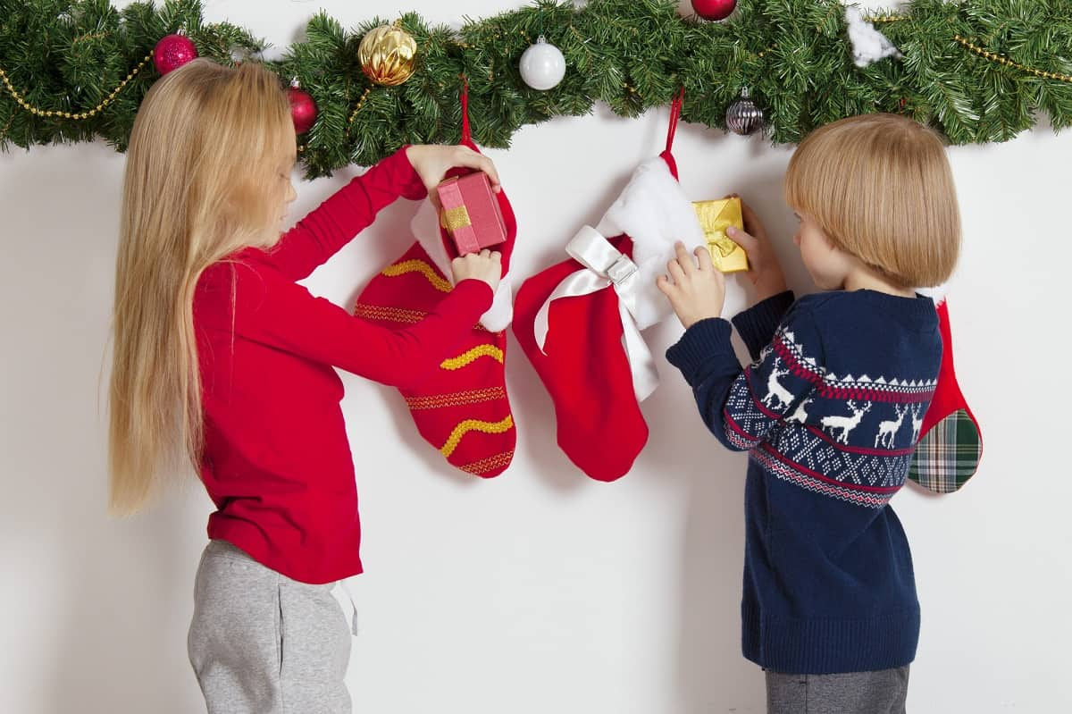 two children looking in their stockings