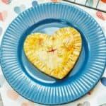 An air fryer cherry hand pie on a blue plate.