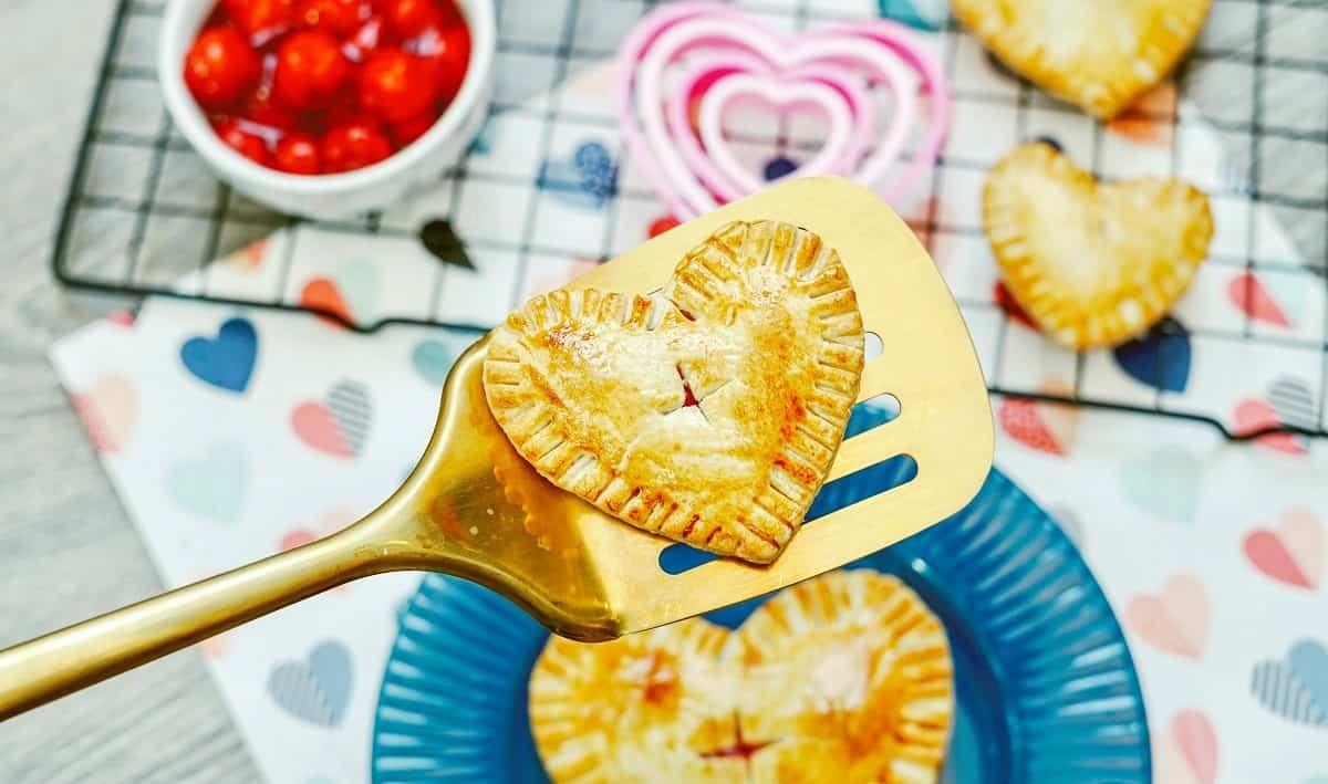 An air fryer cherry hand pie on a spatula.