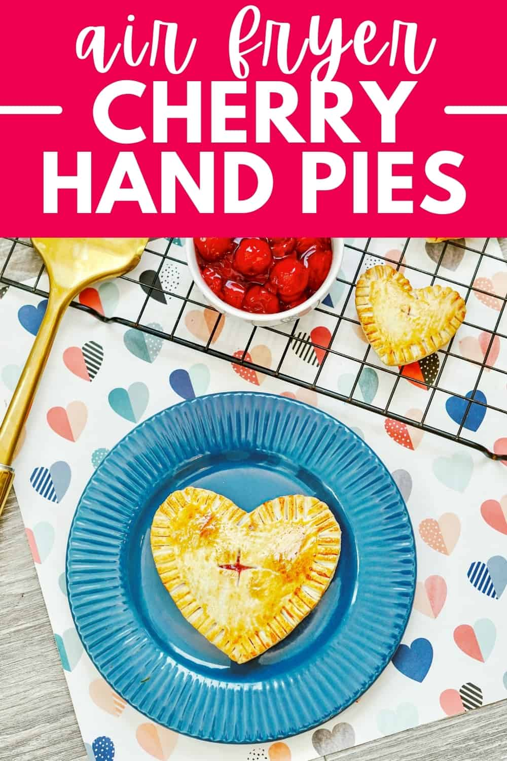 A hand pie on a blue plate on top of a napkin with hearts.