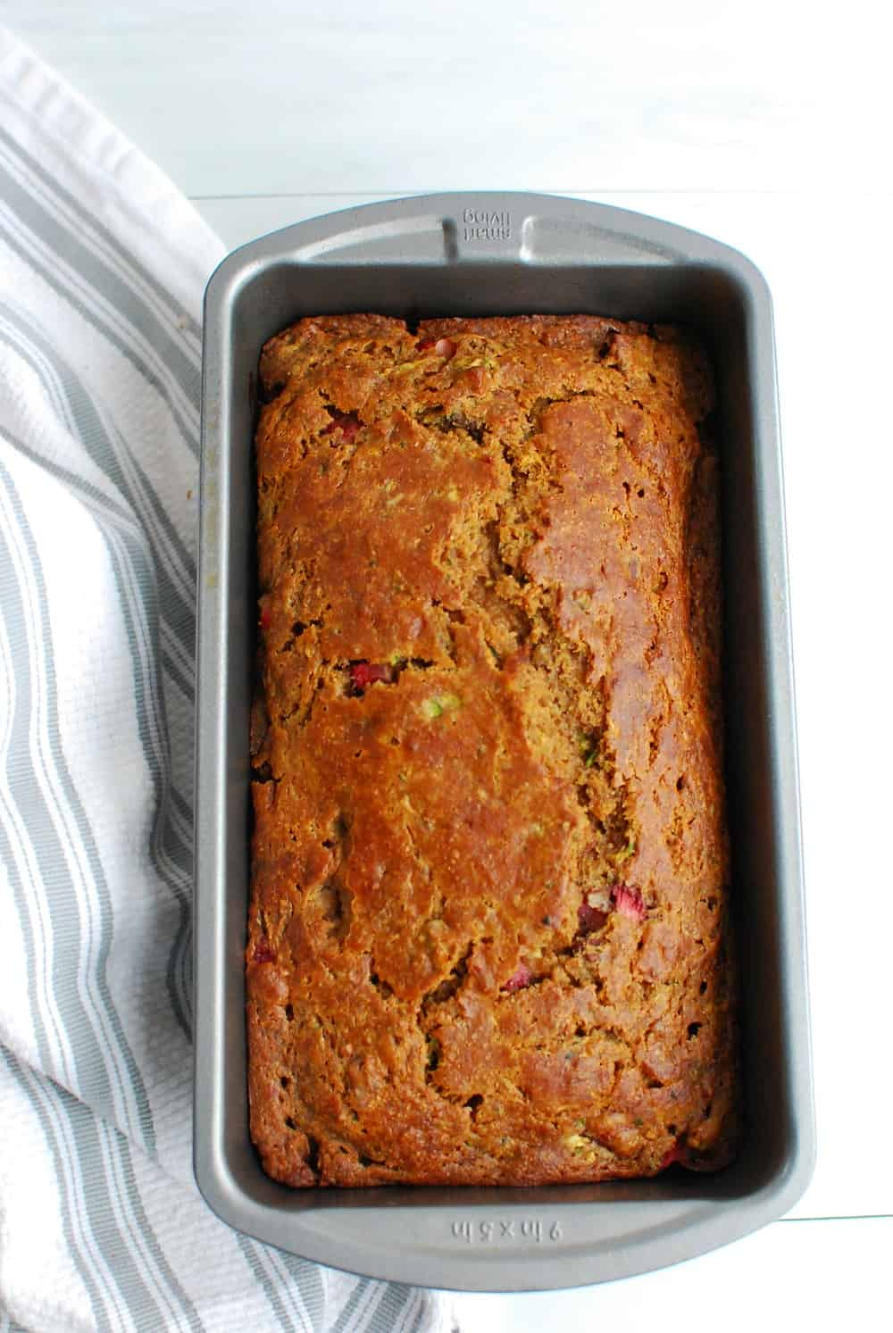 Cooked zucchini strawberry bread still in the loaf pan.