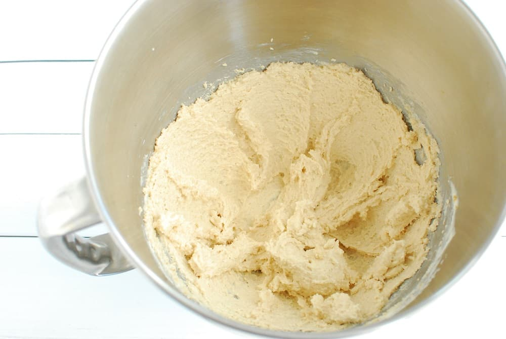 A mixing bowl with dairy free butter and sugar that has been creamed together.