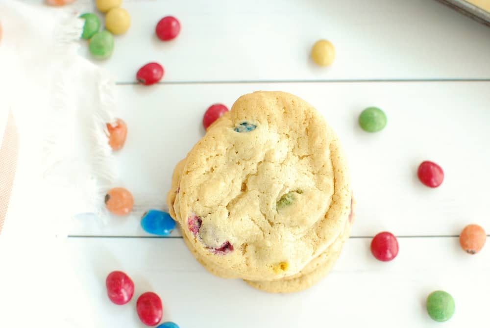 Overhead shot of a dairy free candy cookie next to some extra candies.
