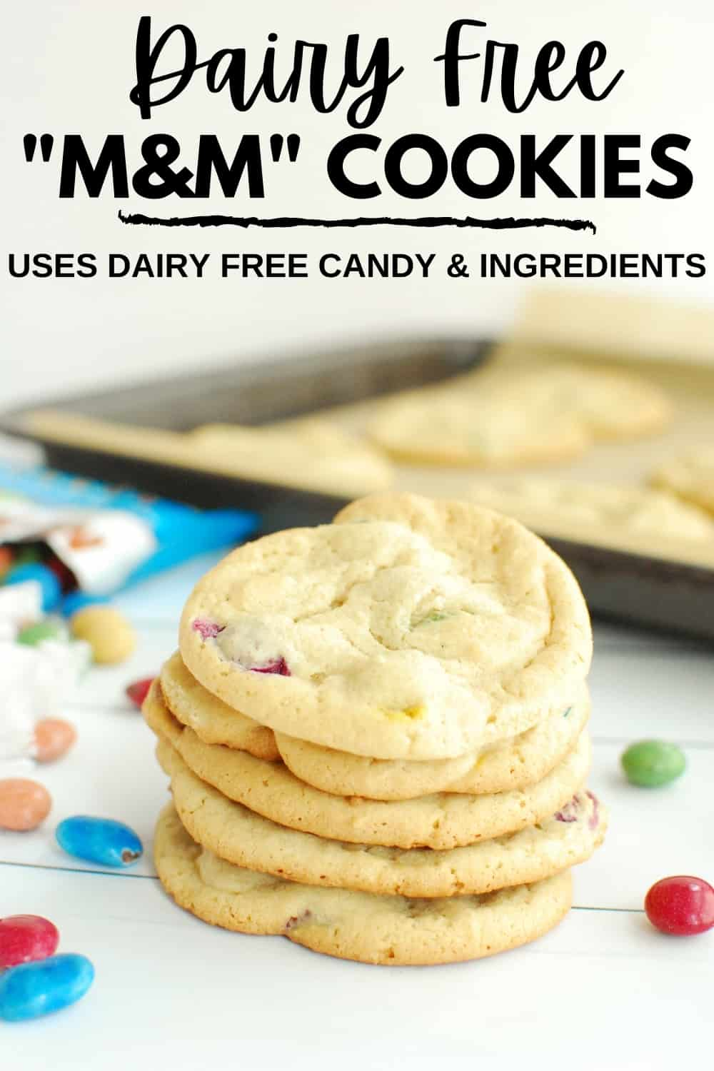 Several dairy free M&M cookies piled on top of each other.