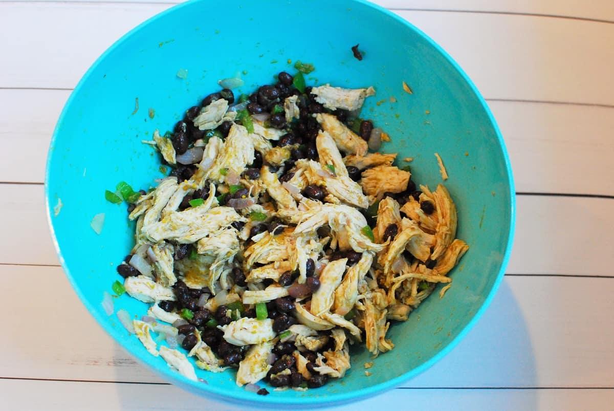 Enchilada filling in a blue bowl.