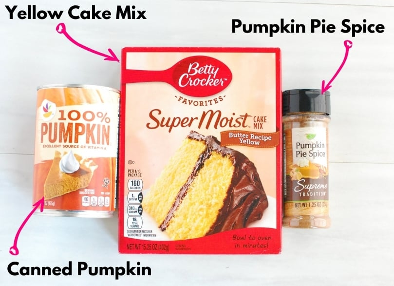 A box of yellow cake mix, a can of pumpkin, and a jar of pumpkin pie spice.