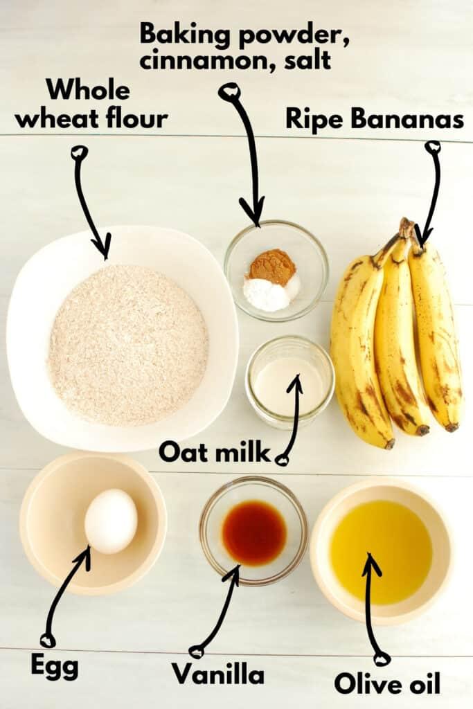 All of the ingrediets - flour, baking powder, cinnamon, salt, bananas, oat milk, egg, vanilla, and olive oil.
